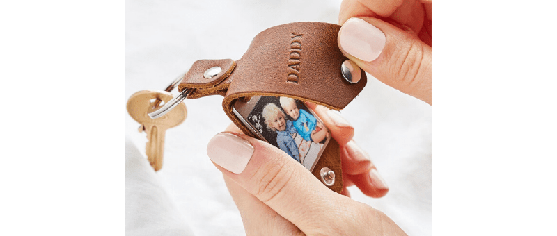 "leather keychain personalized with ""daddy"" and photo of kids"