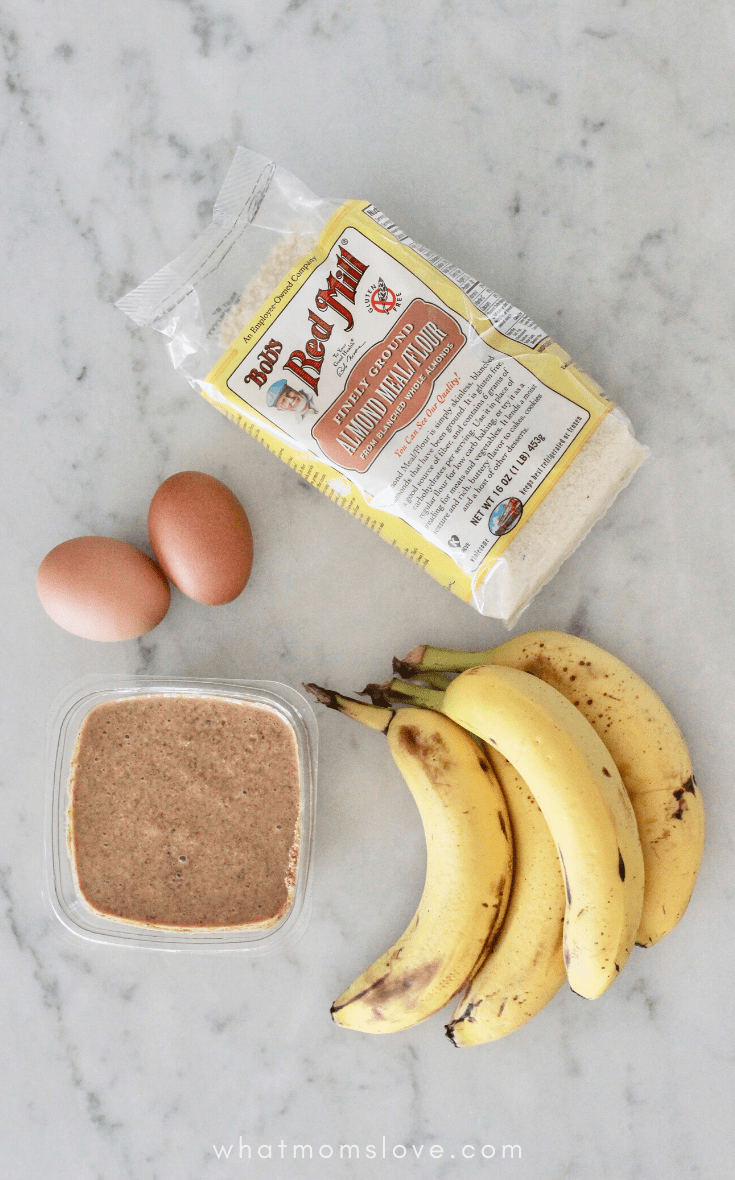 ingredients for banana pancakes - eggs, almond butter, almond flour and bananas